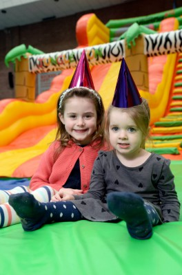 Two children with party hats