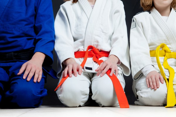 Kids sitting in Karate outfits