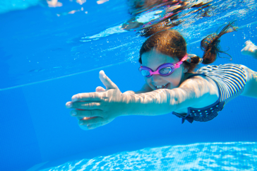Child Swimming with swimming goggles on