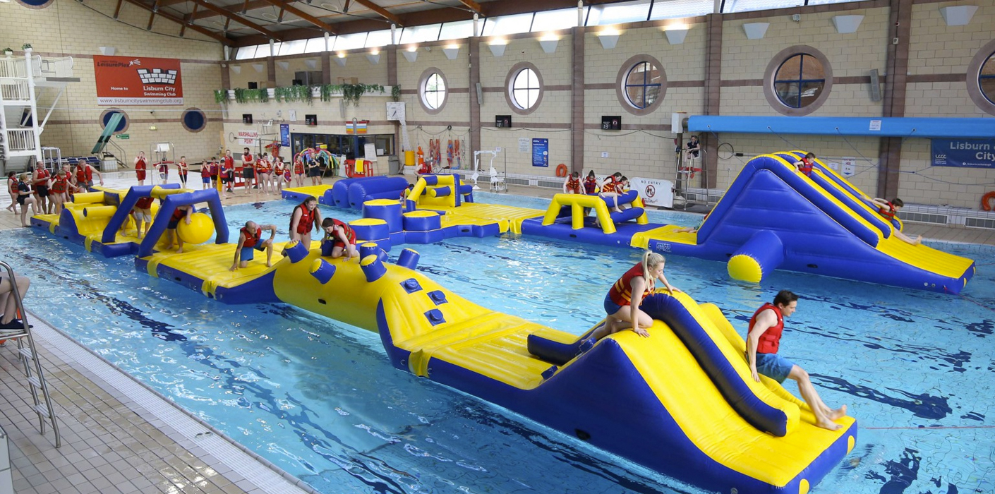 Children on inflatable water assault course